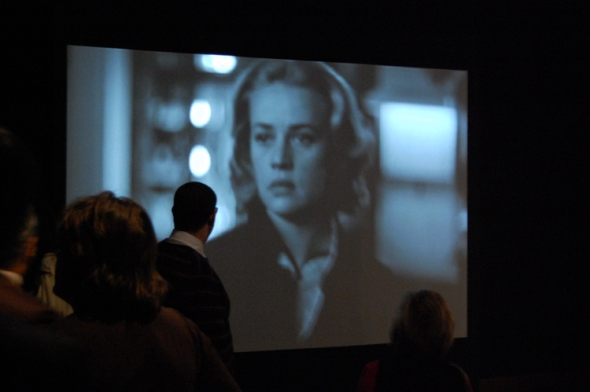 "Jeanne Morreau on large screen in ""We Want Miles"" exhibition"